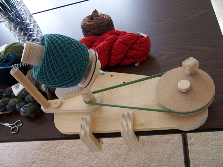 """Ball Winder from above. Notice the nice crosswound center-pull """"cake ..."""